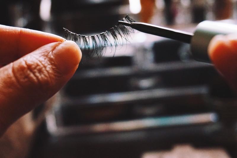 Putting glue on lashes